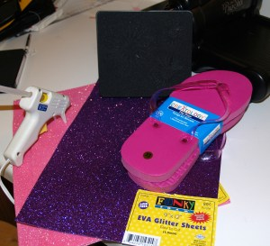 Materials Needed:  1 sheet of each color of sparkly fun foam, available at Hobby Lobby, flip-flops, hot glue, and the Flower Daisies #2 Die.