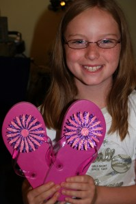 Haley showing off her new flip flops that she made!